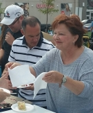 Lynne serving Mayor Bigger's birthday cake